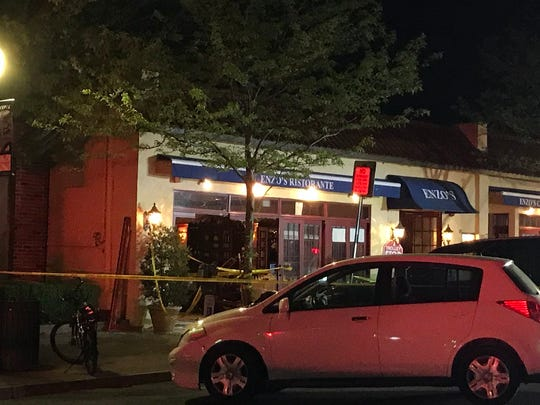 The red car that drove into Enzo's Ristorante can be seen from outside. But it's still inside the restaurant, spectators say.