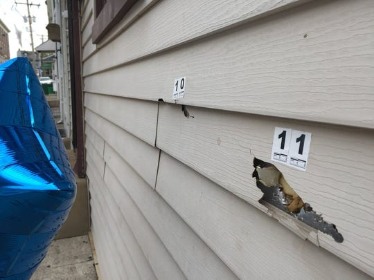 York City Police marked where bullets tore into this home on North Franklin Street in York, during an investigating into the shooting death of Philip Trent Banks Jr.
