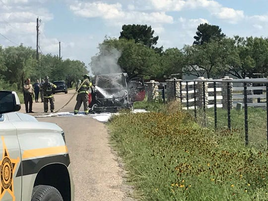 Firefighters douse a vehicle fire on Ratliff Road Thursday, May 25, 2018.