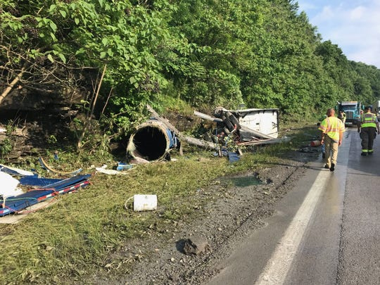 One lane of Interstate 75 South in Campbell County remained closed Thursday after a tanker hauling copper sulfate crashed, causing a chemical spill.