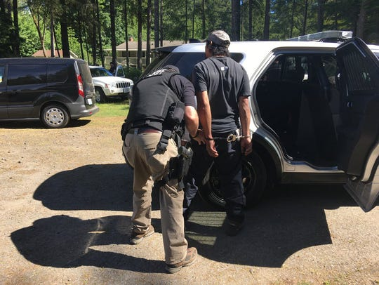 A suspect is arrested in June after the scene of an alleged cockfighting operation in South Kitsap was raided.