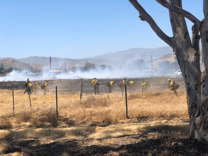 Firefighters attack a small vegetation fire in Santa