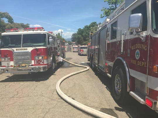 Redding fire engines swarm the area of a garage fire in the 1800 block of Mesa Street on Friday, June 15, 2018.