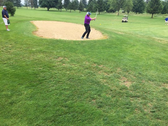 Dan Brown chips out of the bunker on the way to shooting