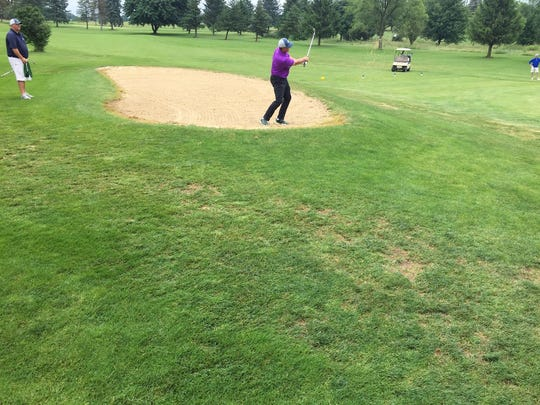 Dan Brown chips out of the bunker on the way to shooting a 71 in the first round of the Lebanon County Amateur on Saturday at Blue Mountain.
