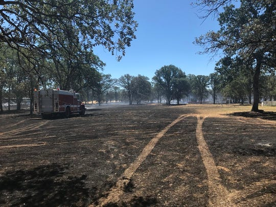 A fire burned 20 acres on Saturday, June 23, 2018 off Tarmac Road in Redding.