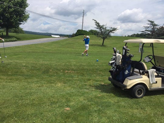 Dan Brown, the 2017 champ, tees off on No. 11. Brown finished in a tie for second with John DiGiacomo and Steve Allwein.