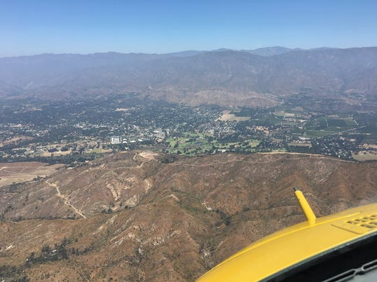 A helicopter crew's view of terrain off Highway 33 above Ojai on the way to rescue an injured motorcycle rider Sunday.