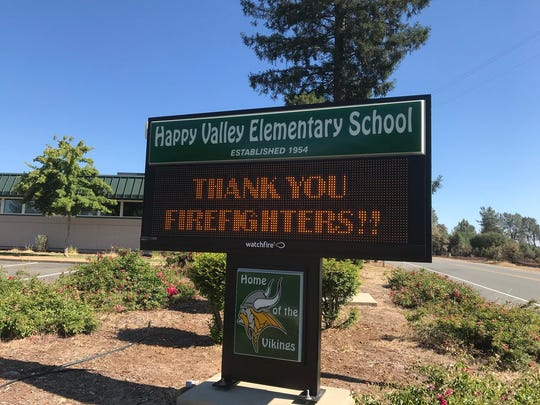 A sign on Monday, June 25, 2018 at Happy Valley Elementary School thanks firefighters battling the Creek Fire. A series of suspicious fires broke out the day before, on Sunday.