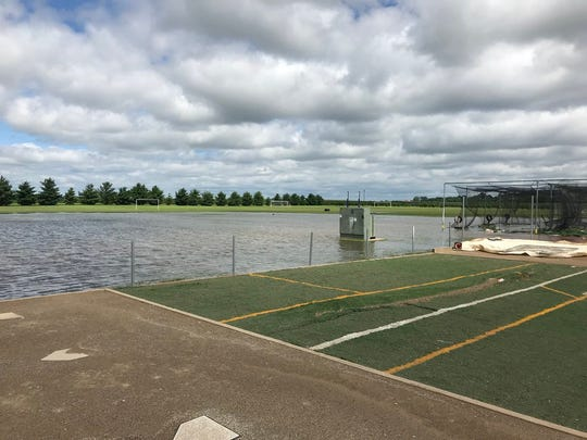 Johnston's baseball field has standing water after flooding July 1, 2018.
