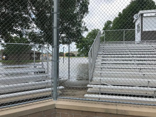 Flooding behind bleachers at Johnston's baseball field after rains on July 1, 2018.