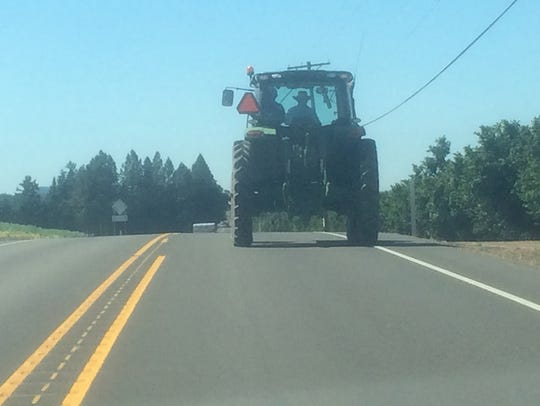 Farm equipment sharing the road in the Mid-Willamette Valley.
