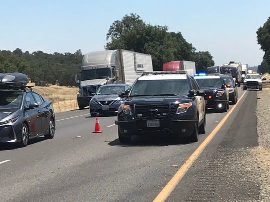 Traffic on Interstate 5 was backed up on Thursday, July 19, 2018 after a truck carrying pineapples overturned and caught fire.