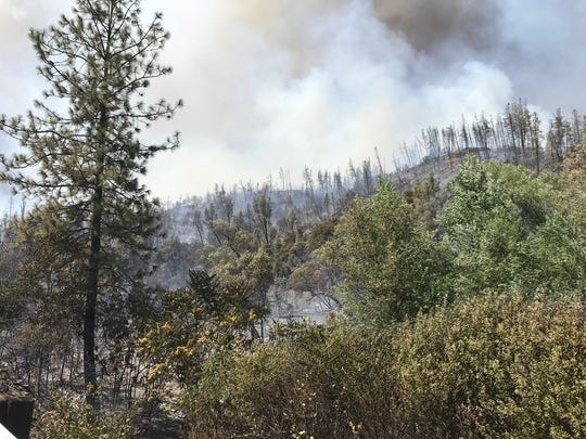 Smoke hovers in the area of French Gulch, where a fire