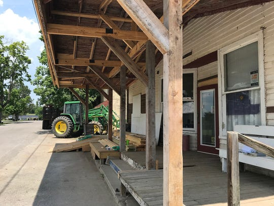 Rebuilding the dilapidated front porch of the Milton