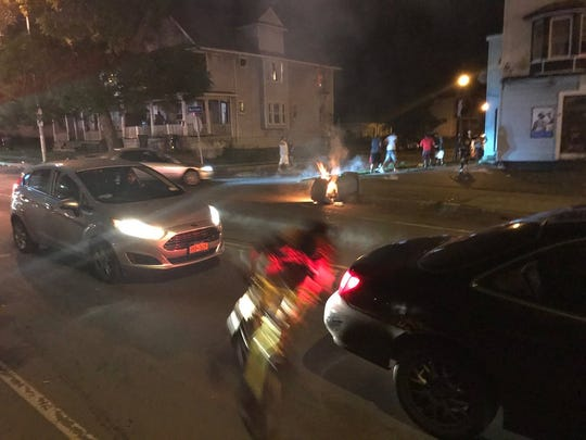 A garbage can on fire at Warsaw and Hudson streets