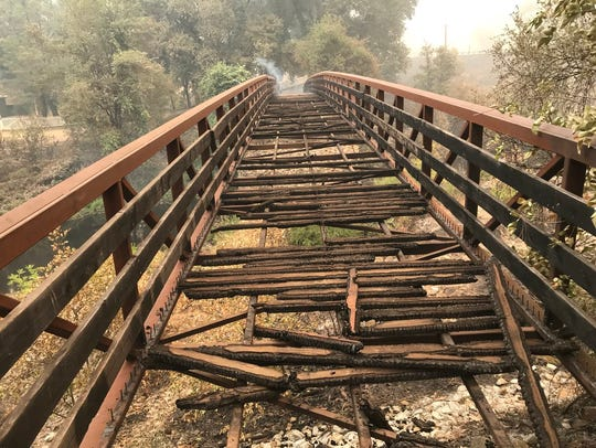 The historic Camden House in the Whiskeytown National Recreation Park barely survived the Carr Fire, but the pedestrian bridge leading to it did not.