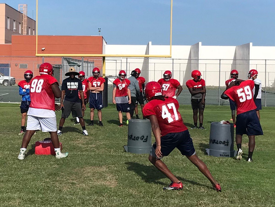 Centennial football players practice on Wednesday,