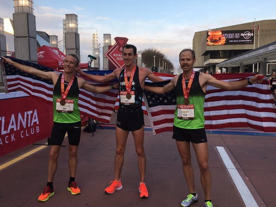 Road to Gold winner Brogan Austin, center, with third-place