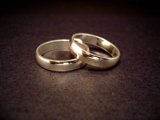 635504535401902081-Wedding-rings