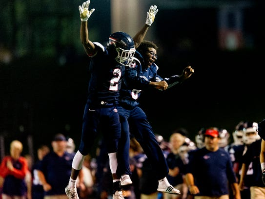 South Doyle's Elijah Young (2) and Ralph Lee (8) celebrate