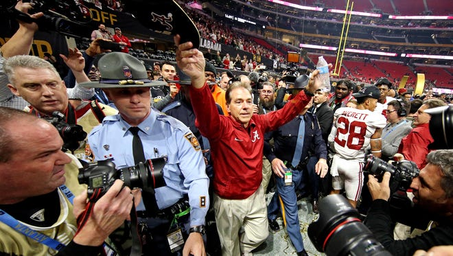 Alabama Crimson Tide head coach Nick Saban celebrates Monday night after beating the Georgia Bulldogs in the 2018 CFP national championship college football game.