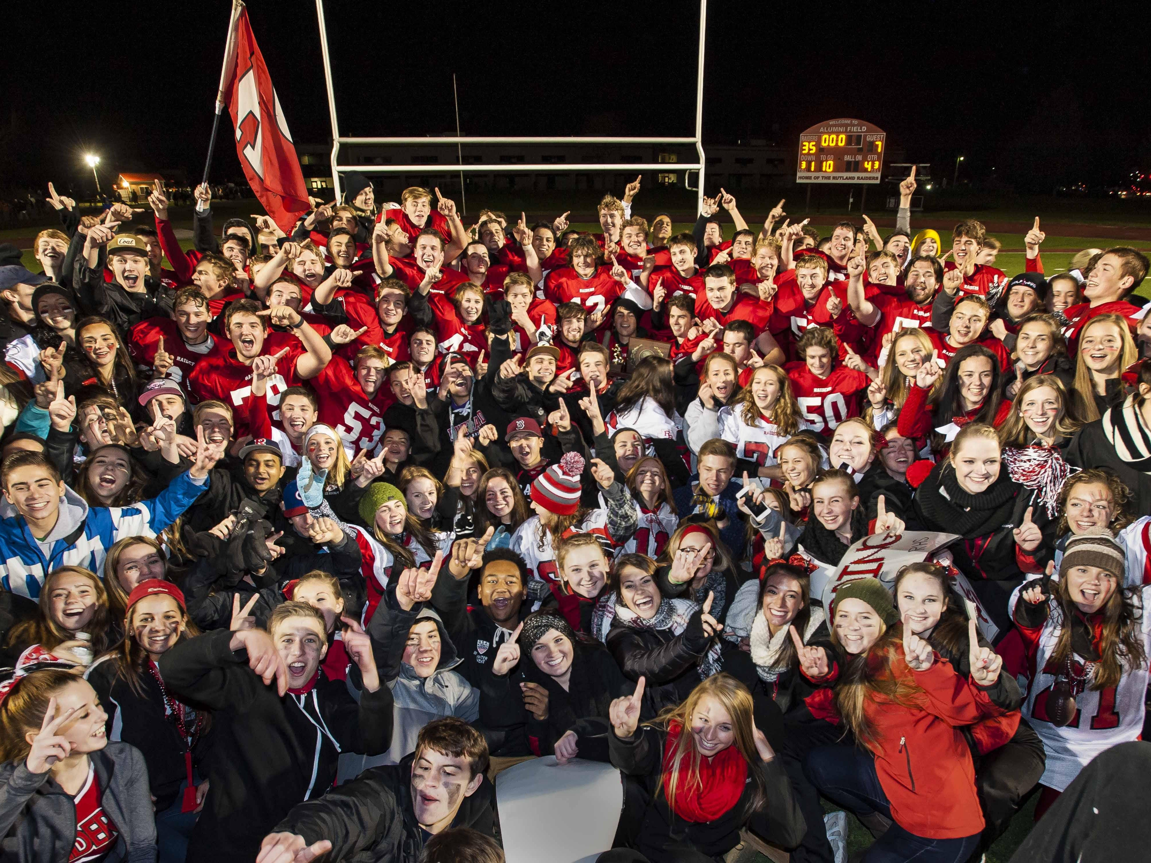 Rutland players and fans celebrate the Red Raiders' victory over Middlebury in the D1 state football championship in Rutland on Saturday, November 7, 2015.