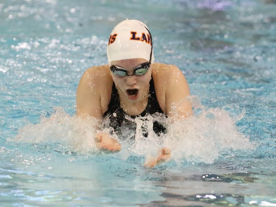 Sophomore Coco Fraser swims the breaststroke during