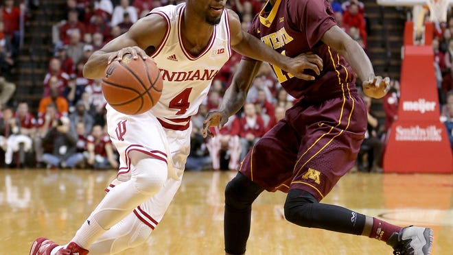 Indiana Hoosiers guard Robert Johnson (4) drives on Minnesota Golden Gophers guard Carlos Morris (11) in the first half of their game Sunday, February 15, 2015, evening at Assembly Hall in Bloomington. Williams was injured on this play.