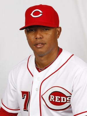 The Reds will need to make a spot for infielder Ramon Santiago on the roster.