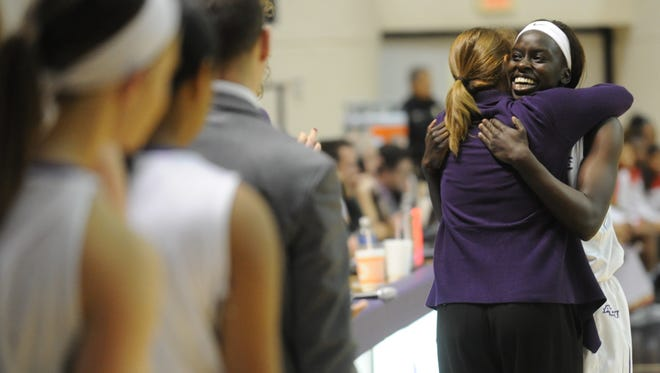 ACU senior Lizzy Dimba, right, gets a hug from coach Julie Goodenough after leaving the game in the final minutes of a 77-59 victory over Lamar on Saturday, Jan. 14, 2017 at Moody Coliseum.