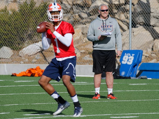 UTEP JC transfer Kai Locksley, from Fort Washington, Md. looks for a receiver downfield as spring practice opened Monday at Glory Field under new head coach Dana Dimel and an entire new coaching staff. Dimel looks on as practice got underway.