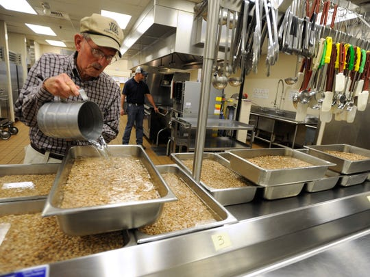 Head cook George Woodfin soaks pinto beans in the kitchen at Craig Middle School preparing for the 2016 Greater Kiwanis of Abilene Chili Day.