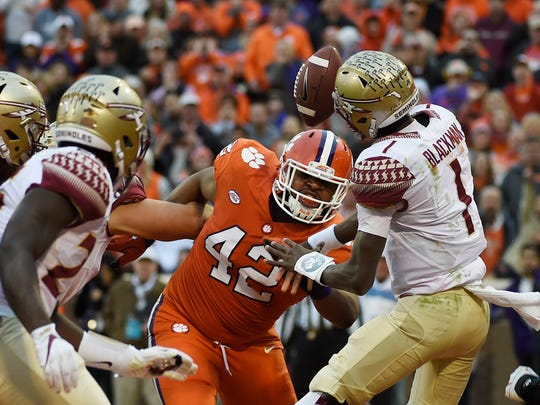 Clemson defensive lineman Christian Wilkins (42) blocks a pass from Florida State quarterback James Blackman (1) during the first half of an NCAA college football game, Saturday, Nov. 11, 2017, in Clemson, S.C. (AP Photo/Rainier Ehrhardt)