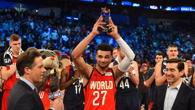 Feb 17, 2017; New Orleans, LA, USA; World Team guard Jamal Murray of the Denver Nuggets (27) celebrates winning the MVP during the Rising Stars Challenge at Smoothie King Center.