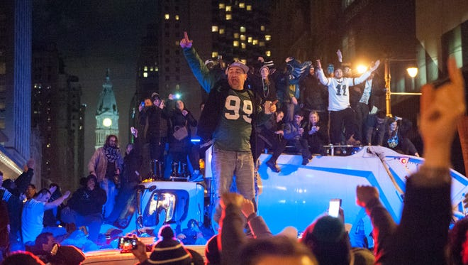 Eagles fans celebrate in Center City Philadelphia following the Super Bowl win against the New England Patriots Sunday, Feb. 4, 2018.