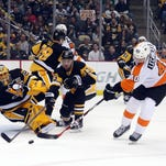 Philadelphia's Claude Giroux (28) cross checks Pittsburgh's Sidney Crosby (87) to the ice during the second period.