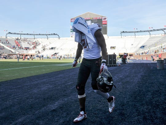Receiver Keenan Barnes, injured in UL's 50-22 loss to Ole Miss last season, walks off the field at Vaught-Hemingway Stadium in Oxford, Mississippi.