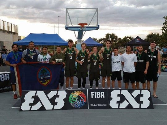 Team Guam proudly displays the Guam flag after accepting the bronze medal in the FIBA 3X3 Oceania Championships held in Australia. At center is gold medalists Australia and at right, the silver medalists from New Zealand.