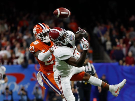 Clemson Tigers safety Van Smith (23) breaks up a pass intended for Alabama Crimson Tide wide receiver Calvin Ridley (3) during the second quarter.