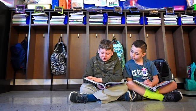 Elijah Stamper and Mason Cross read in the third grade classroom of  Andrea Davis class at Granbery Elementary Tuesday Jan. 31, 2017, in Nashville, Tenn.