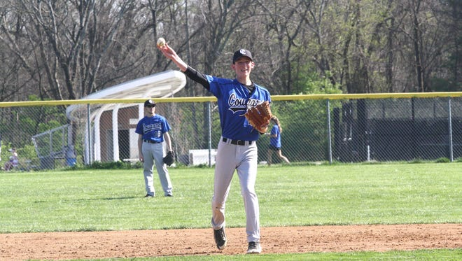 Cincinnati Christian's Mitchell Smith makes a play at shortstop at Cincinnati Country Day on April 12.