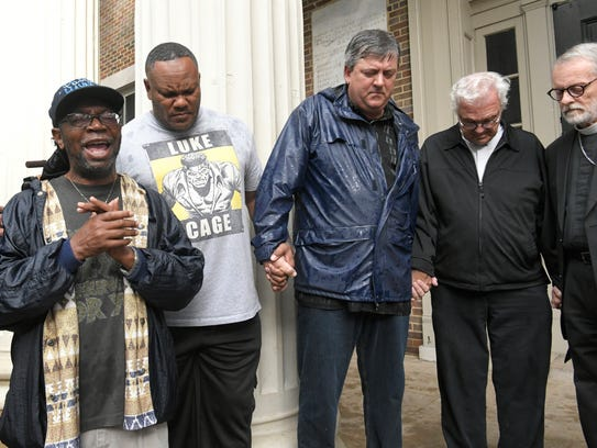 Local clergy pray for peace during a Stand in Solidarity