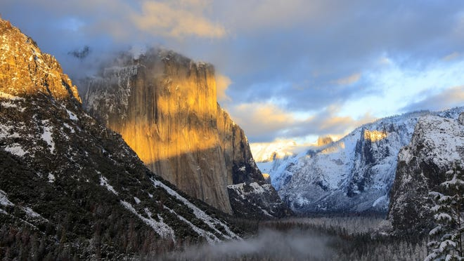 Sunset splashes the top of Yosemite's famous El Capitan with color on a January day. The 3,000-foot granite face is a favorite with rock climbers.