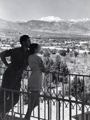 Frank Bogert and model enjoying the view from the El Mirador bell tower, circa 1939.