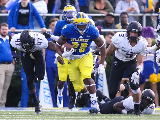 Delaware running back Kani Kane breaks a long gain