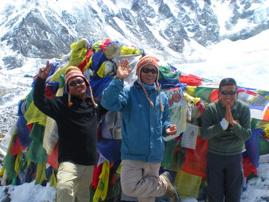 Right, Ongyel Sherpa with other guides in the mountains