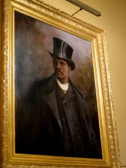 Master Decorative Painter Joshua Risner has also completed a portrait of the first African-American representative, Willam Webb Ferguson. Friday, July 13, 2018.