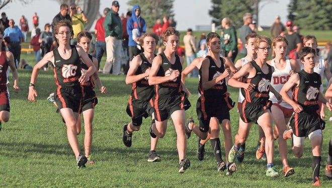 The Grinnell Tigers boys cross country team takes off at the start of the Little Hawkeye Conference championships at Ahrens Park on Monday, Oct. 12. The Tigers captured the conference crown 40-41 with Dallas Center-Grimes in second on Monday, Oct. 12.