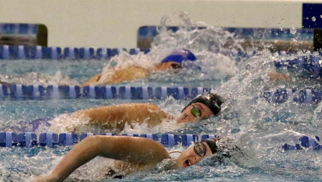 Maddy Rogan of Horseheads, center, swims to sixth place in the 100-yard freestyle Saturday at the New York State Girls Swimming and Diving Championships at Ithaca College.